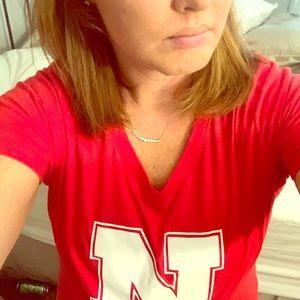 New era N, ladies v-neck Nebraska Husker T-shirt.